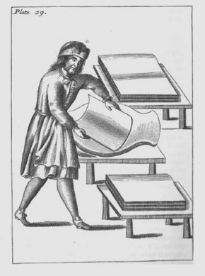 Black and white drawing of a printer with comically small feet